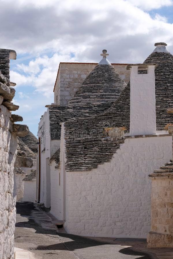 View of group of traditional trulli houses in the Aia Piccola residential area of Alberobello in the Itria Valley, Puglia Italy. View of group of traditional royalty free stock photo