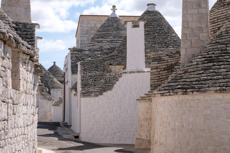 View of group of traditional trullo houses in the Aia Piccola residential area of Alberobello in the Itria Valley, Puglia Italy. View of group of traditional stock photo