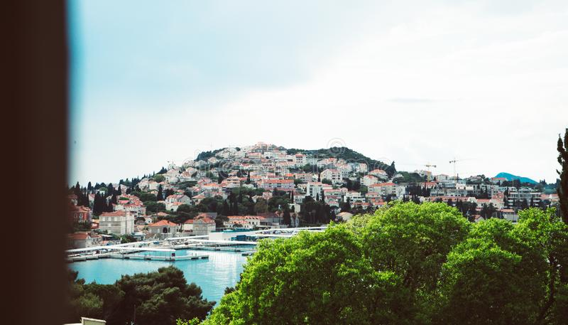 View of Gruz neighborhood and the lapad peninsular of Dubrovnik during sunrise with the Adriatic sea in the background. Croatia stock images