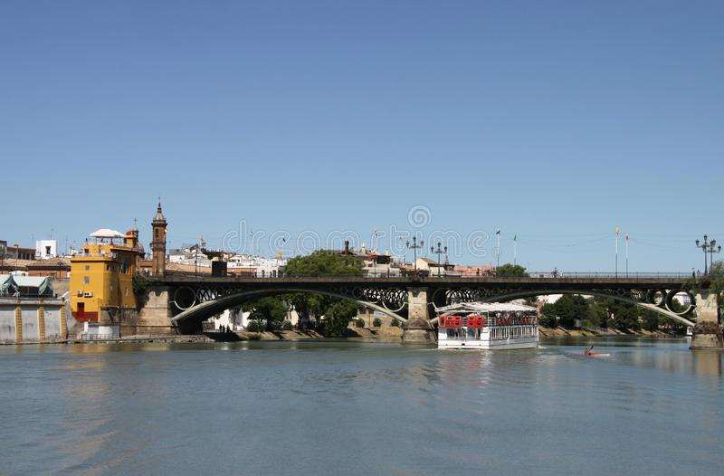 View of the Guadalquivir River and the Isabella II Bridge in Seville stock photography