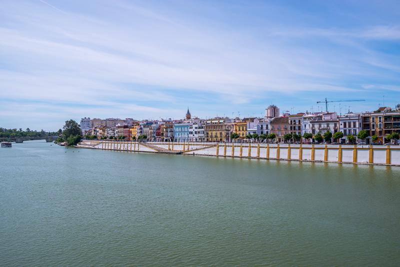 May 2019  View of Guadalquivir river in Seville, Spain. View Guadalquivir river in Seville, Spain stock photo