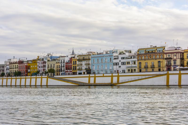 View of Guadalquivir river and Triana district in Sevilla, Andalusia, Spain. Quiet scene of Guadalquivir river and Triana district in Sevilla, Andalusia, Spain stock photo