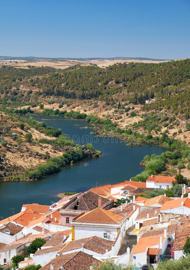 View of Guadiana river bend and residential houses of Mertola city on the ripe. Mertola. Portugal. View of Guadiana river bend and residential houses of Mertola stock images