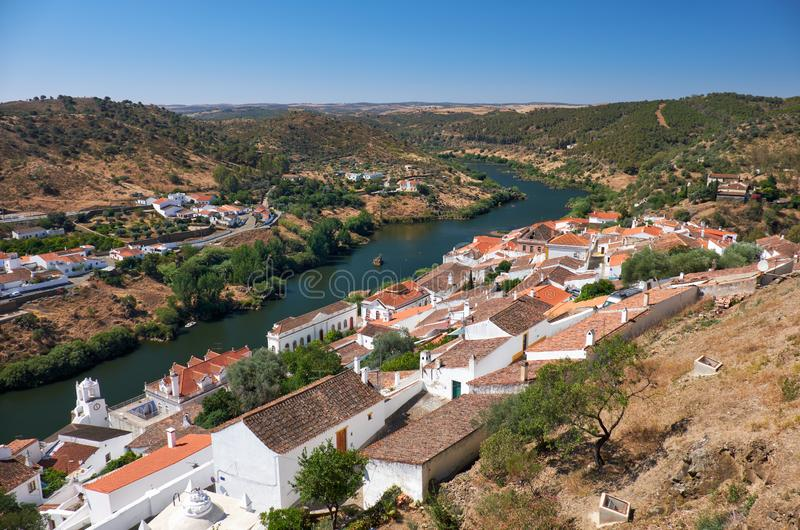 View of Guadiana river bend and residential houses of Mertola city on the ripe. Mertola. Portugal. View of Guadiana river bend and residential houses of Mertola stock photo