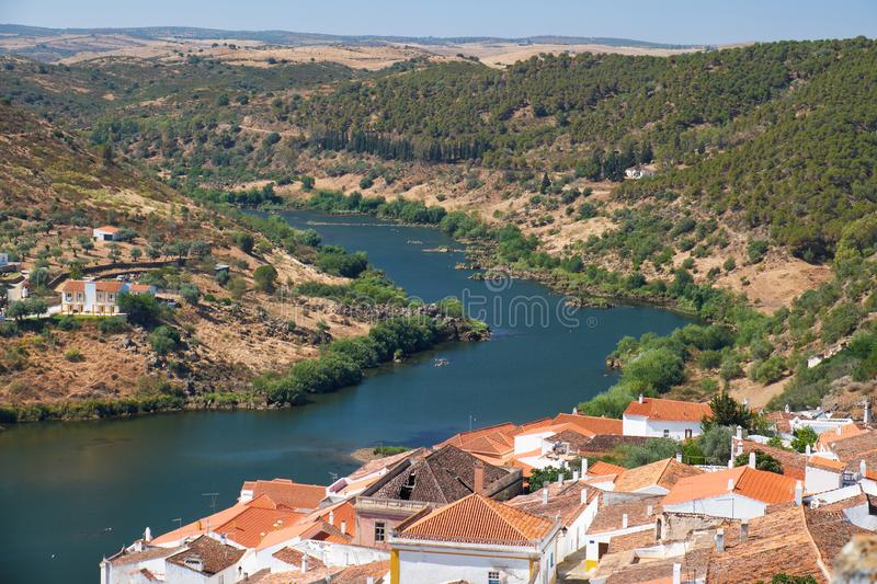 View of Guadiana river bend and residential houses of Mertola city on the ripe. Mertola. Portugal. View of Guadiana river bend and residential houses of Mertola royalty free stock images