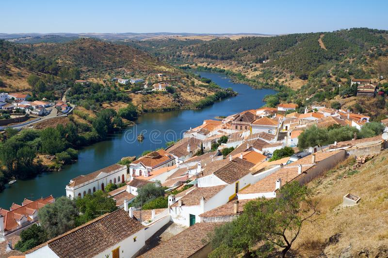 View of Guadiana river bend and residential houses of Mertola city on the ripe. Mertola. Portugal. View of Guadiana river bend and residential houses of Mertola royalty free stock photography