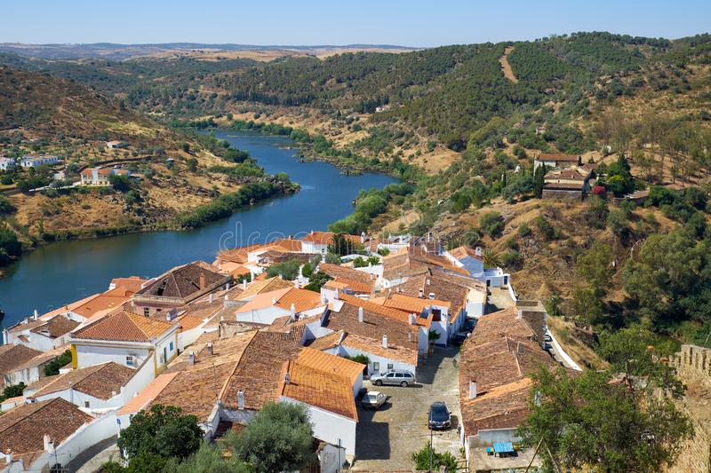 View of Guadiana river bend and residential houses of Mertola city on the ripe. Mertola. Portugal. View of Guadiana river bend and residential houses of Mertola royalty free stock photos