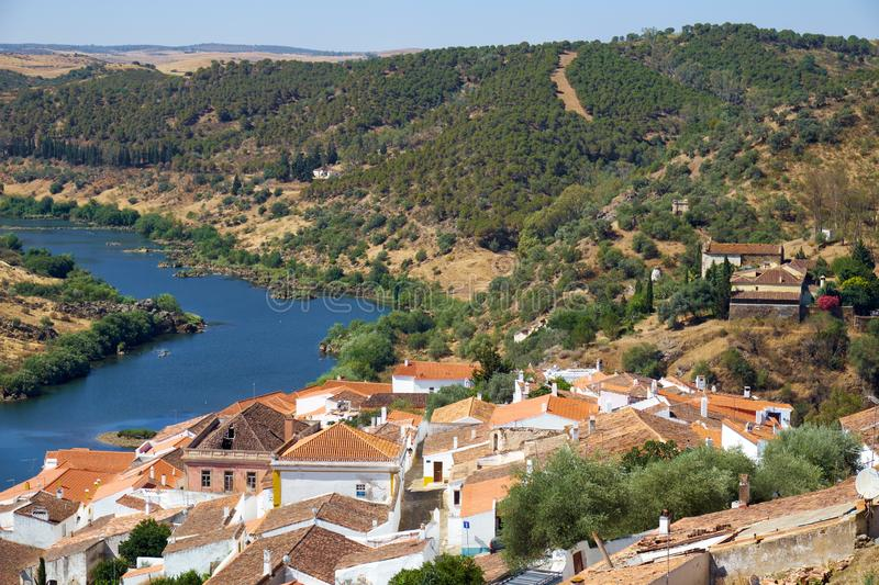 View of Guadiana river bend and residential houses of Mertola city on the ripe. Mertola. Portugal. View of Guadiana river bend and residential houses of Mertola stock photos