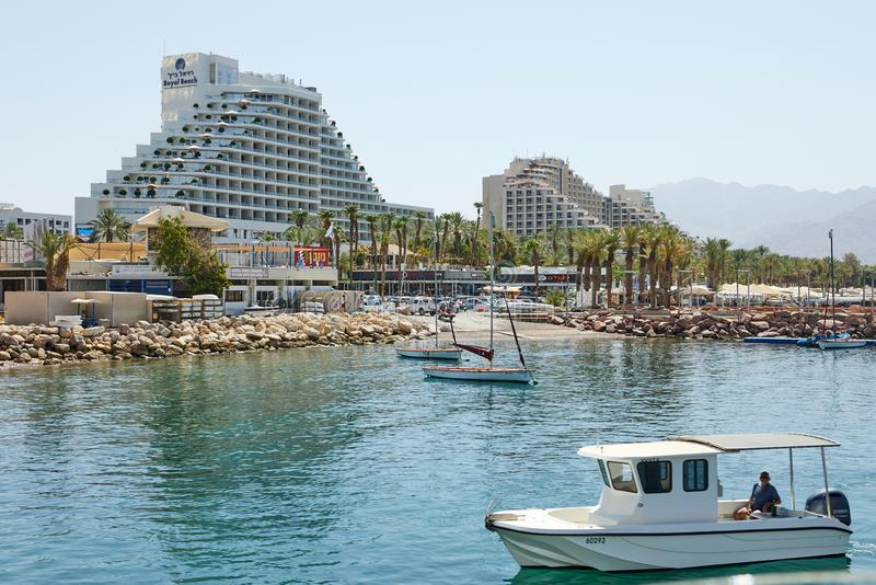 View of the Gulf of Eilat with luxury yachts. Hotels for tourists boats and yachts for a good holiday stock images