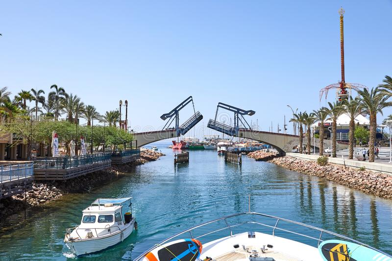View of the Gulf of Eilat with luxury yachts. The moment of opening the bridge to exit the yacht from the bay stock photography