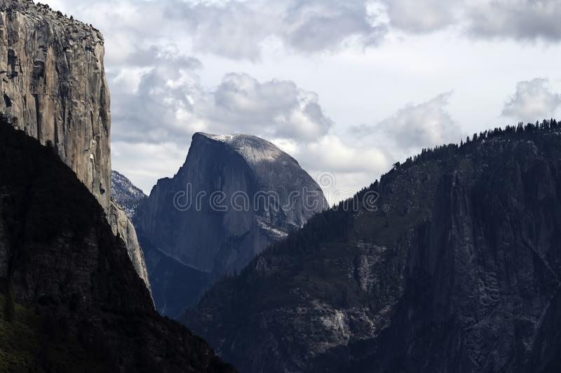 View Of Halfdome And El Capitan Cloudy Day. Yosemite View Of Halfdome And El Capitan Up Valley From Tunnel Entrance With Cloudy Sky stock photos