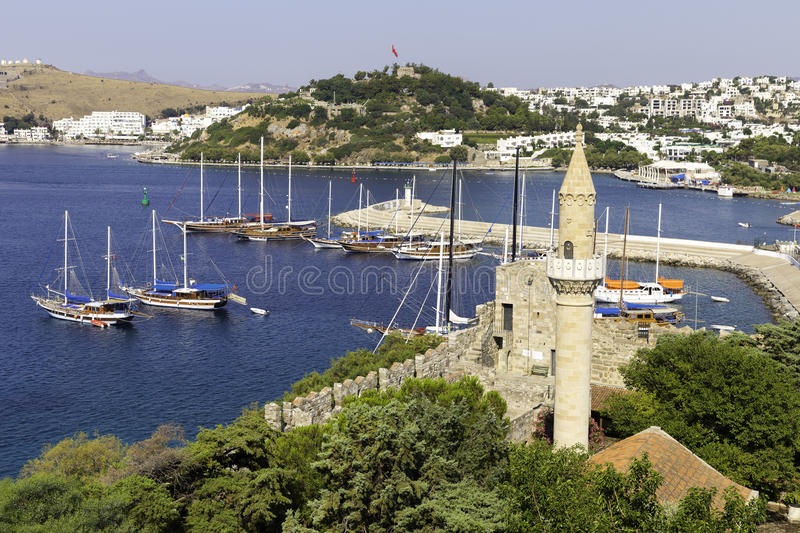 View of Halikarnas, Bodrum marina from Bodrum Castle on Turkish Riviera. Boats, yachts and general marine view with ramparts and mosque foreground stock photo