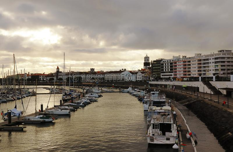 View of harbor at Ponta Delgada, capital city of the Azores at Sao Miguel Island at sunset stock images