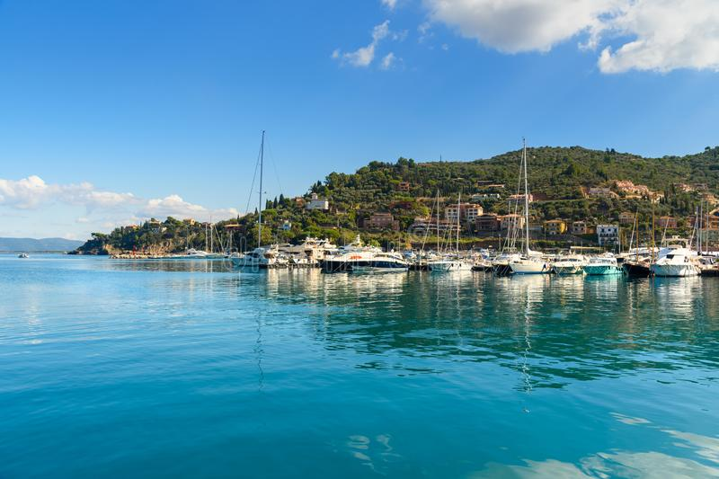 View of harbor seafront in seaport town Porto Santo Stefano in Monte Argentario. Italy royalty free stock photography