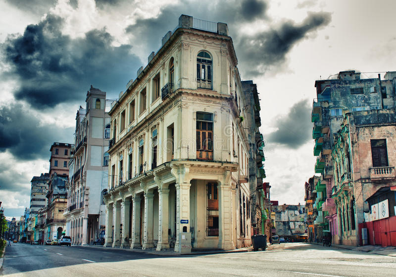 View of Havana street with typical architecture and colonial buildings. Against dramatic storm clouds stock image