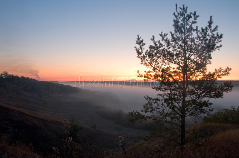 Download View Of Hazy Distance With Hills And Sunrise Royalty Free Stock Image - Image: 11621926