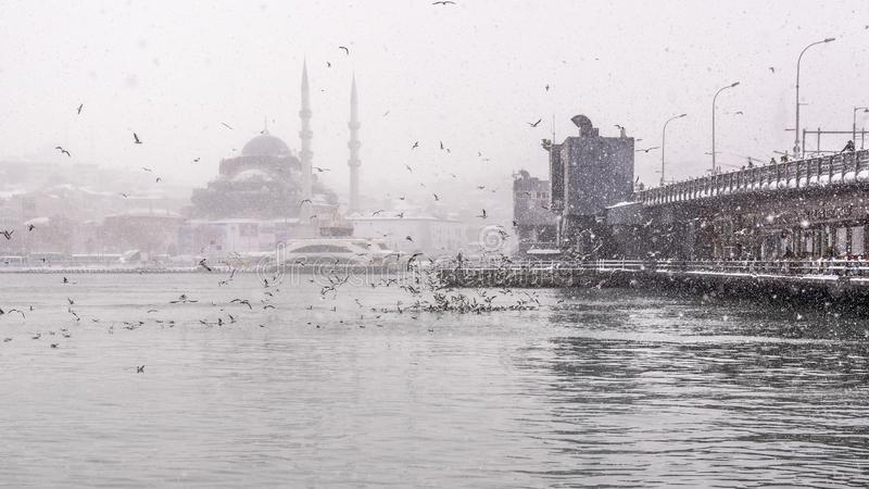 View of heaviest snowfall in Istanbul,Turkey. Heaviest snowfall in Istanbul.Galata bridge and New Mosque is an Ottoman imperial mosque located in the Eminön stock photos