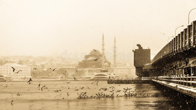 View of heaviest snowfall in Istanbul,Turkey. Heaviest snowfall in Istanbul.Galata bridge and New Mosque is an Ottoman imperial mosque located in the Eminön stock images