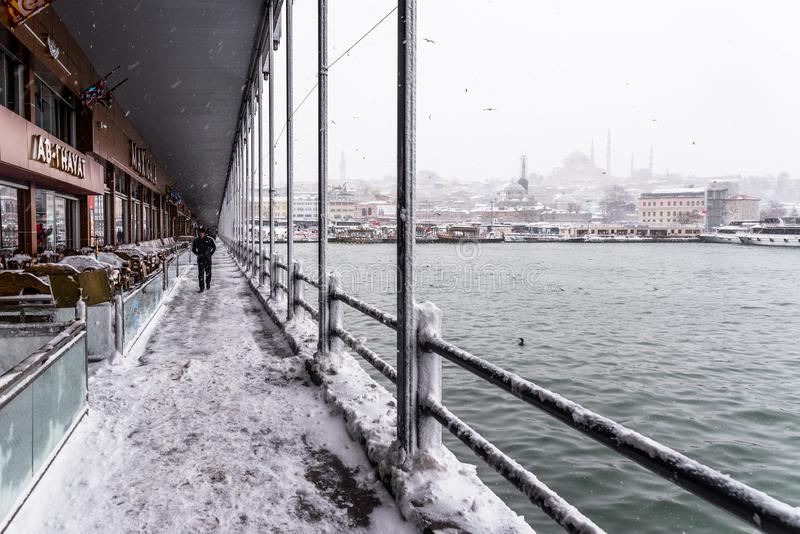 View of heaviest snowfall in Istanbul,Turkey. Heaviest snowfall in Istanbul.Galata bridge and New Mosque is an Ottoman imperial mosque located in the Eminön stock photo