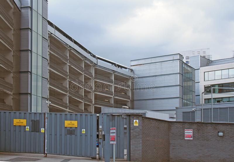 A view of a heavily protected fenced off area with steel gates behind the offices and apartments of the leeds dock area royalty free stock image