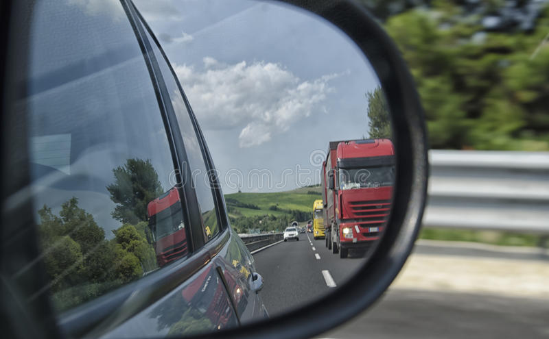 View of heavy traffic on the freeway. Mirror view of heavy traffic on the freeway stock photos