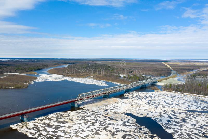 View from the height of the bridge over the river Nadym during the ice drift in Northern Siberia stock photography