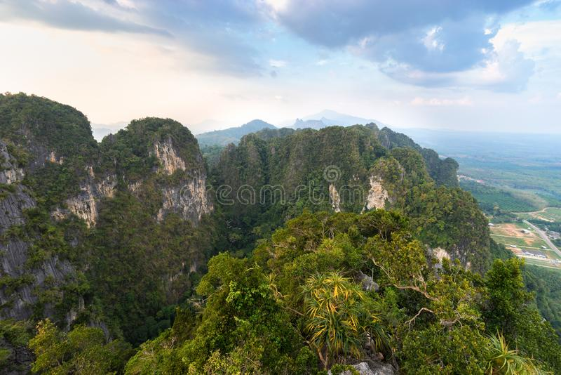 The view from the height on jungle and mountains covered with tropical greenery and trees stock photo