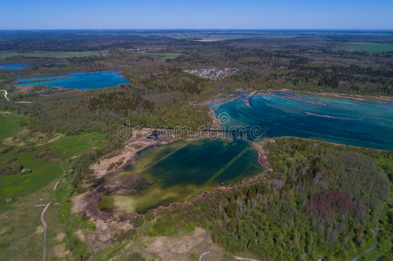 View from height on the lake `Kyurlevskiy quarries`. Leningrad Region, Russia. View from height on the lake `Kyurlevskiy quarries` in the sunny May afternoon royalty free stock images
