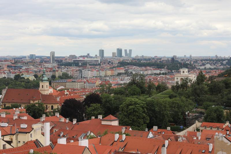 View from height on red-brown roofs of old Prague. stock photos