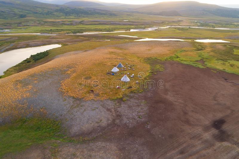 View from height on a settlement of nomads reindeer breeders in the valley of the Longotjyogan River aerial photography. Polar Ural Mountains, Russia stock photos