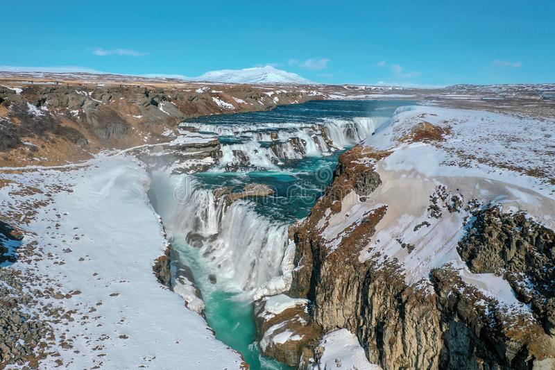A view from the height of the snow-covered waterfall Gullfoss royalty free stock photography