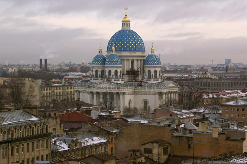 View from height to city buildings in winter. Buildings, roofs of buildings, Cathedral, travel, cityscape, Russia, Saint-Petersburg,sky,clouds,architecture royalty free stock photo