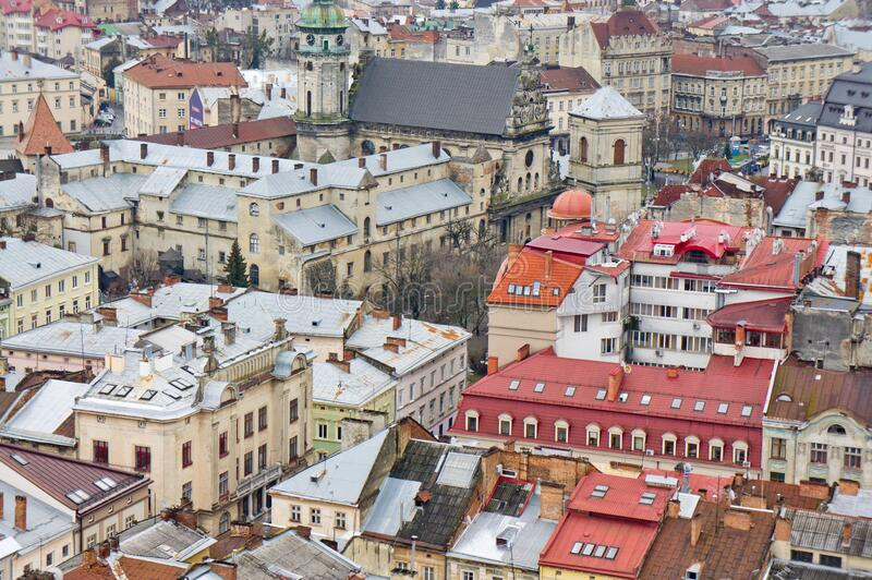The view from the heights of the rooftops of an old European city. Background for urban architecture. Europe royalty free stock photos
