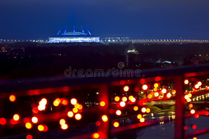 The view from the heights on the Zenit arena in the evening lights in St. Petersburg. Saint-Petersburg .Russia.December 31, 2016.The view from the heights on the stock photography