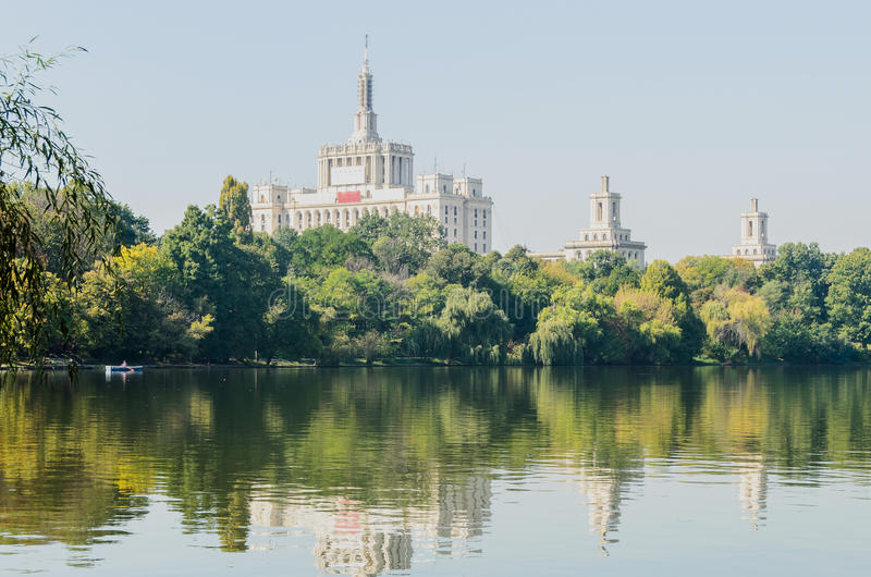 View from Herastrau Park of House of the Free Press. Casa Presei Libere, boat on the lake stock photo