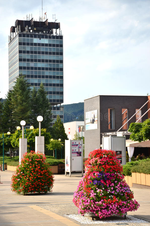 View at high Administrative building of state agencies from flower decorated town centre. Povazska Bystrica, Slovakia - July 8, 2016: View at high Administrative stock photography
