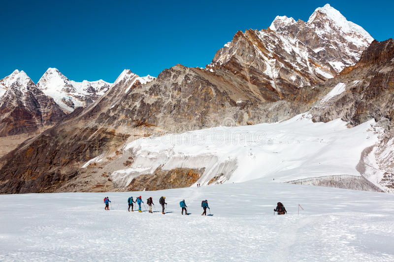 View of high Altitude Himalaya Mountains group of Climbers walking royalty free stock photography