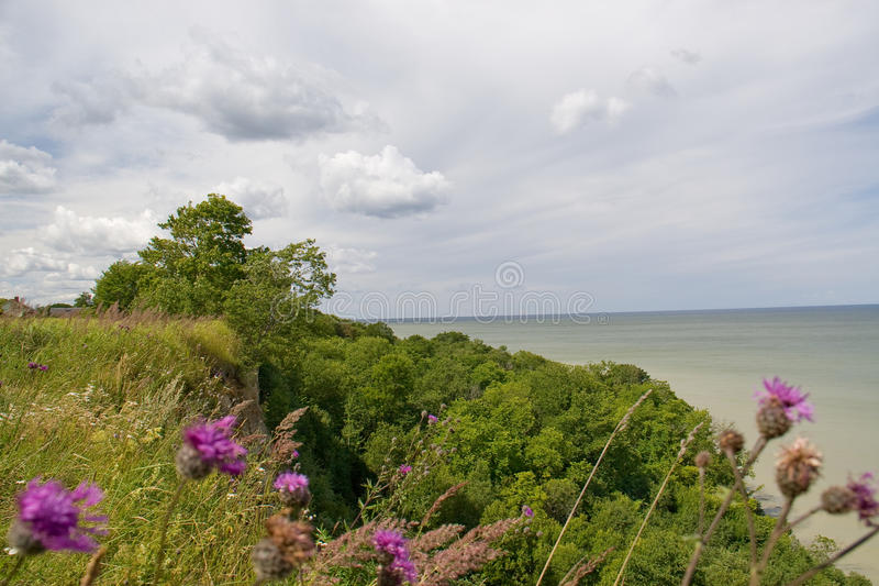 View of the high coas. T on the sea and clouds royalty free stock images