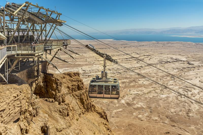 View from a high view of the landscape around the Dead Sea, the parking place in the desert and the starting station of the cable stock image
