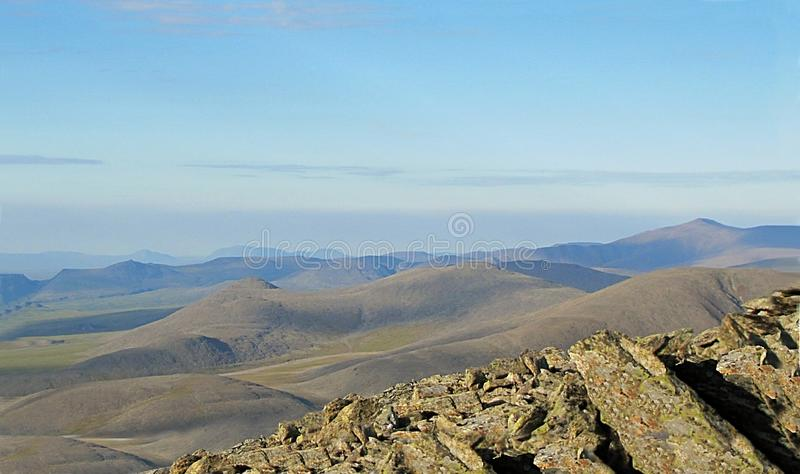 View from a high mountain in the tundra. stock images