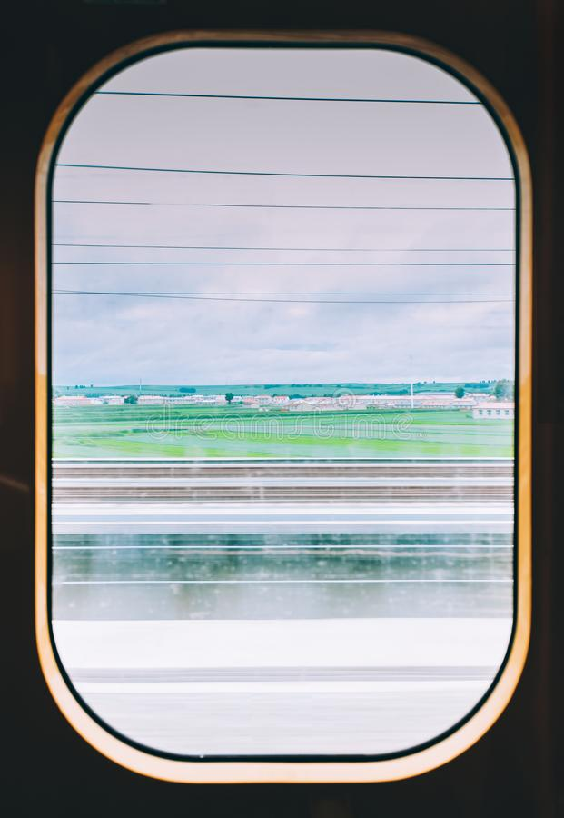 View from high speed train window in motion of countryside royalty free stock images