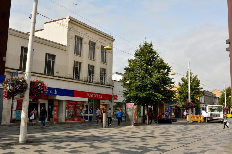 View of High Street in Slough, with historic buildings, commerci. Slough, United Kingdom - September 7, 2017. View of High Street in Slough, with historic stock photography