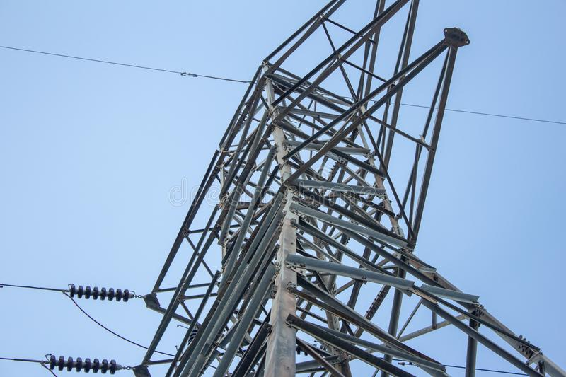 View of high voltage electric pole with blue sky background royalty free stock photography