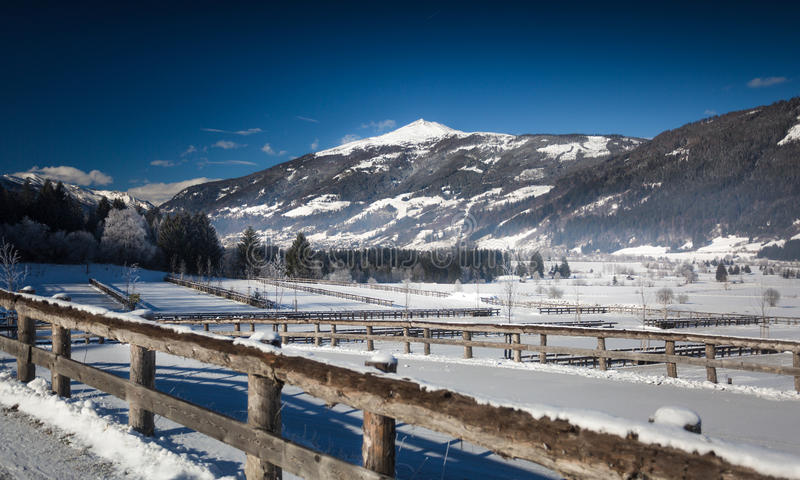 View of highland farm covered by snow in Austrian Alps. Beautiful view of highland farm covered by snow in Austrian Alps stock image