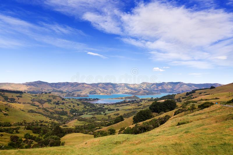 A view from a hill to Barrys bay near Akaroa, New Zealand. stock photos