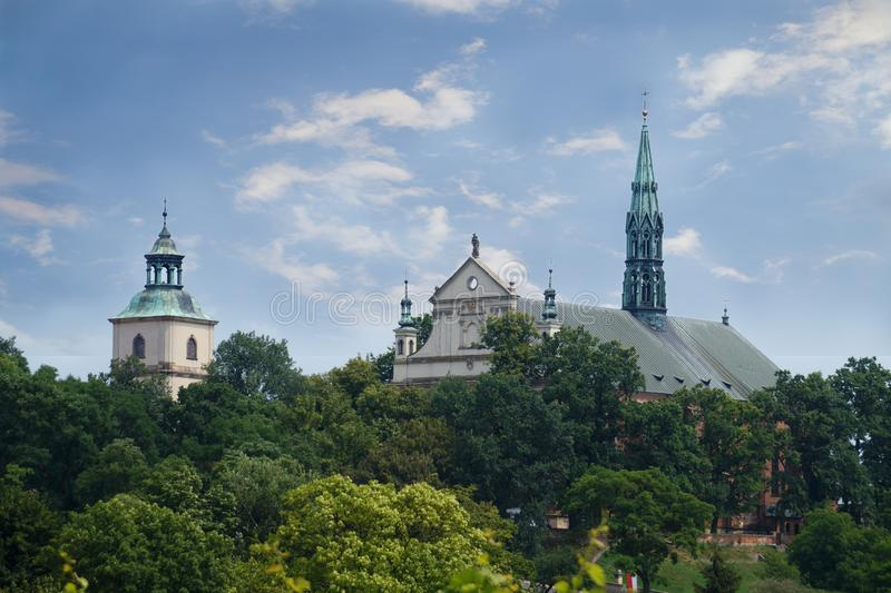 View from the hill to the Roman Catholic basilica and the cathedral belfry. Sandomierz. Poland. royalty free stock image
