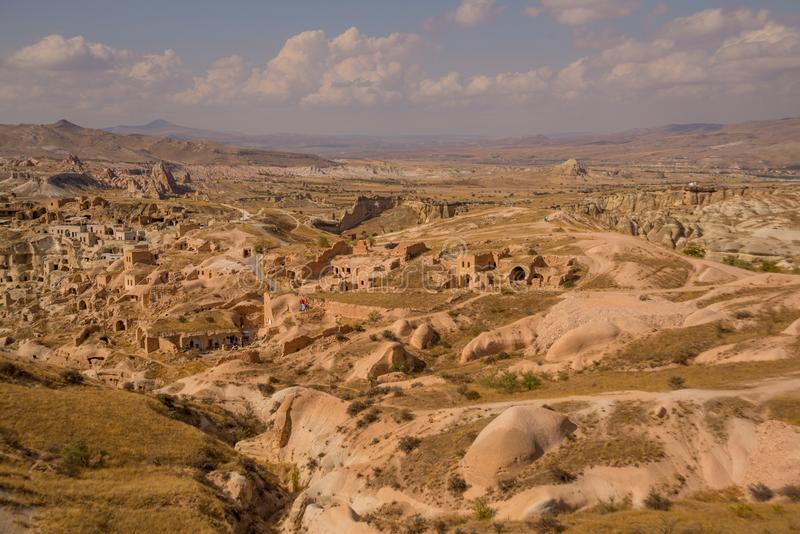 View from the hill to the traditional Turkish houses in the rocks in the village Cavusin near Goreme in Cappadocia. Turkey stock photos