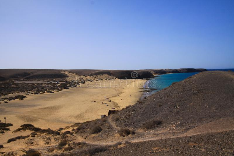 View from hill on wide beach with fine sand - Playa Mujeres, Playa Blanca, Lanzarote stock image