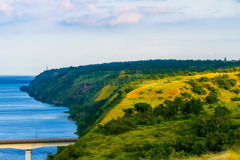View of hills and steppe and a modern bridge over upper river Don in Russia. Background, beautiful, blue, bright, calm, coast, construction, cossacks royalty free stock photography