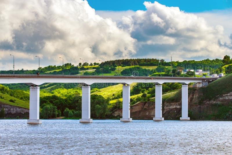 View of hills and steppe and a modern bridge over upper river Don in Russia. Background, beautiful, blue, bright, calm, coast, construction, cossacks royalty free stock images